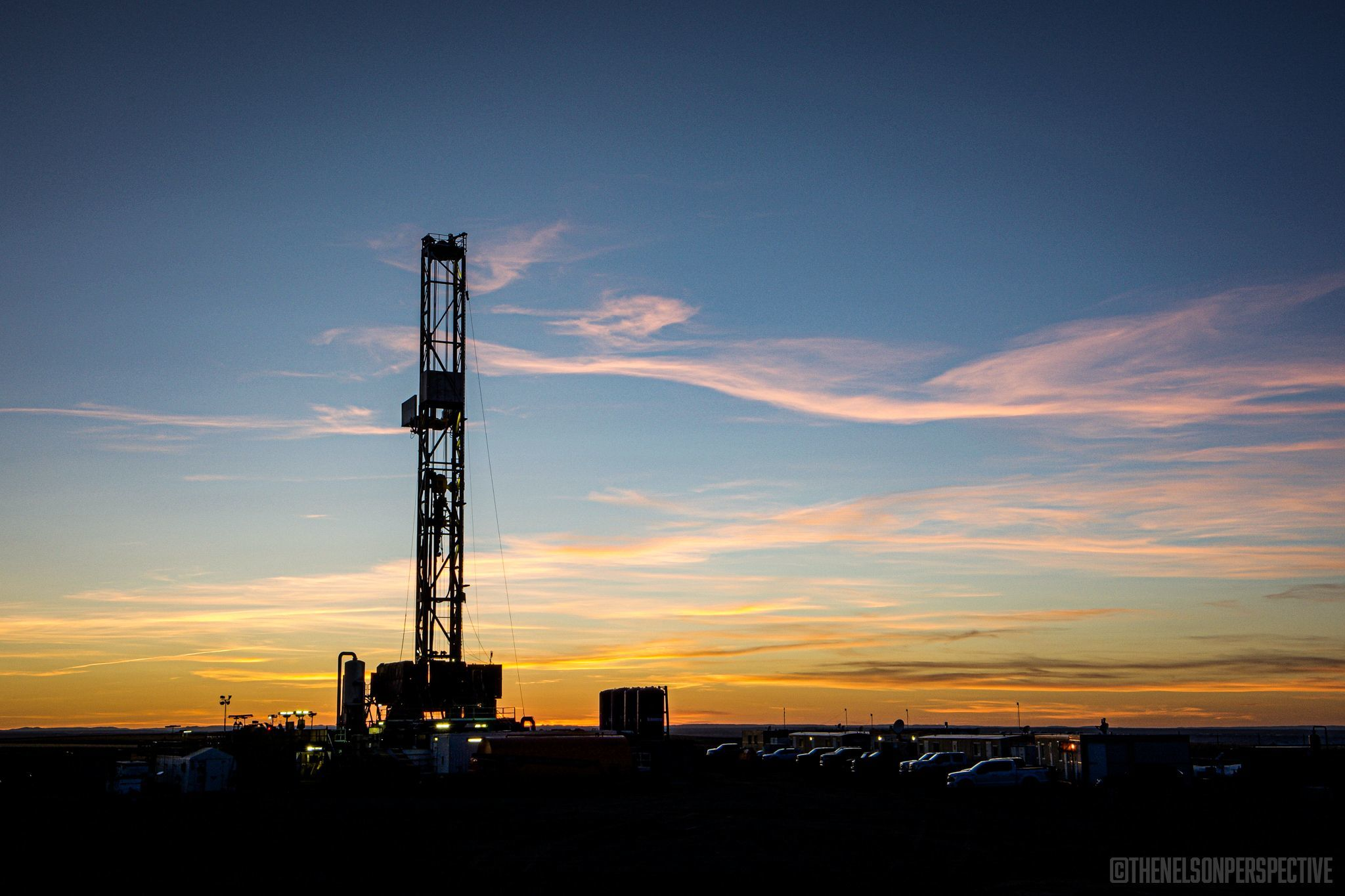 Oil rig with sunset in the background.
