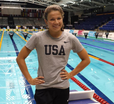 A picture of Becca Meyers in front of a pool wearing a USA shirt