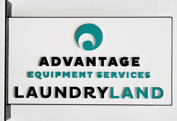 S28179 - Carved Sign  for Advantage Equipment Services Laundryland, with Steel Perimeter frame and Side Bracket for Wall Installation