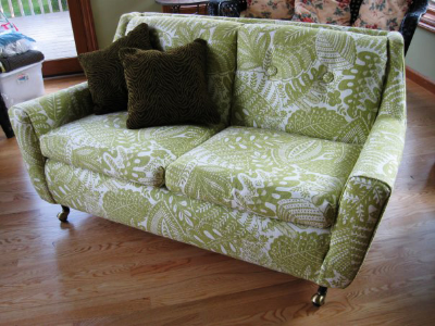 Thrifted sofa from Goodwill with green floral pattern.