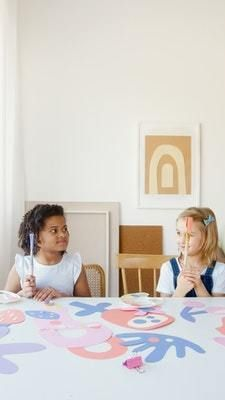 children painting together