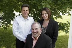 Jerry Velona, Dave Theriault (seated) and Tracie Theriault - founders of Elite Envelope & Graphics, Inc.