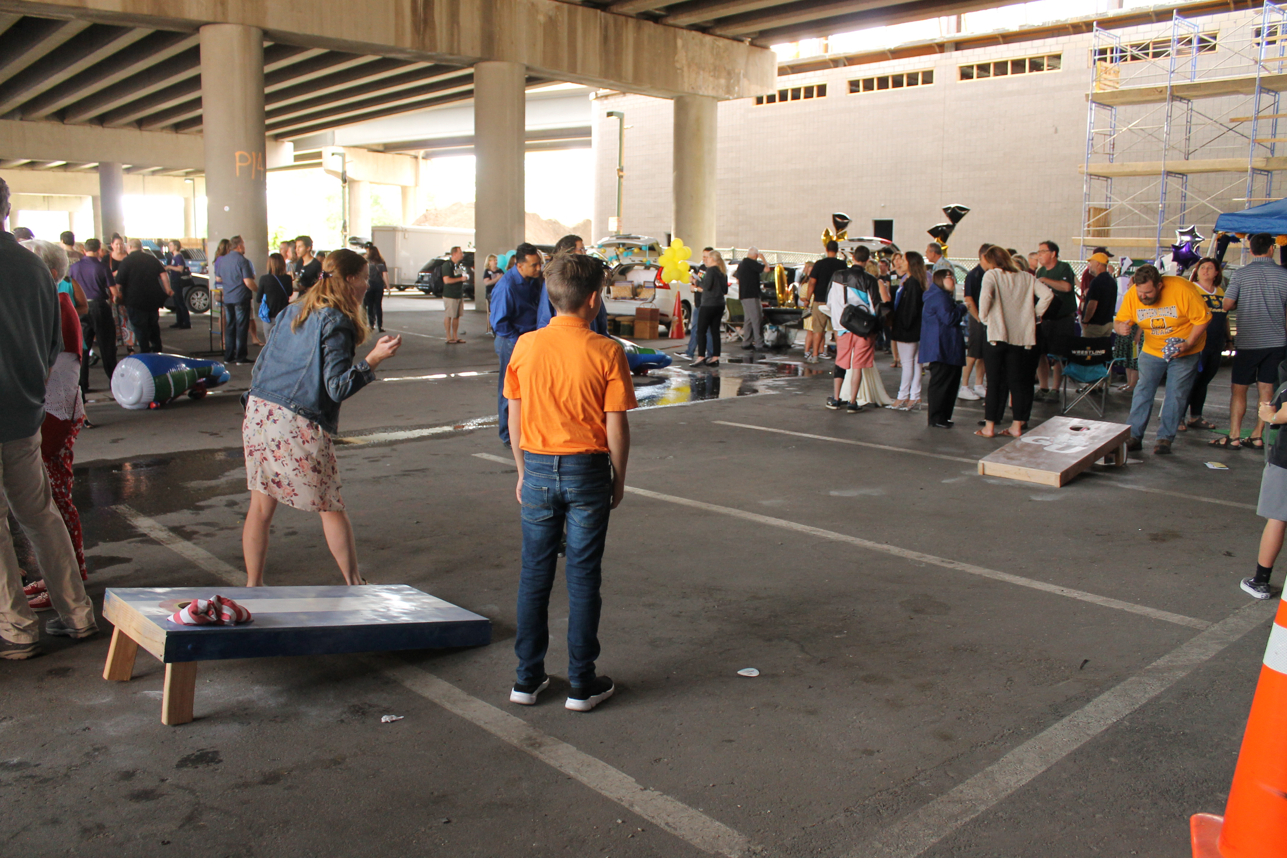 Group of people plays corn hole