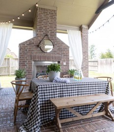 Backyard patio with fireplace and string lights featured on Crazy Wonderful Blog.