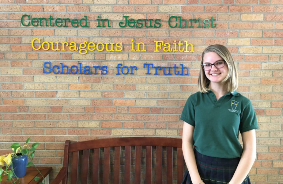 She wasn't Catholic when she started going to Catholic school. Now she and five others are.