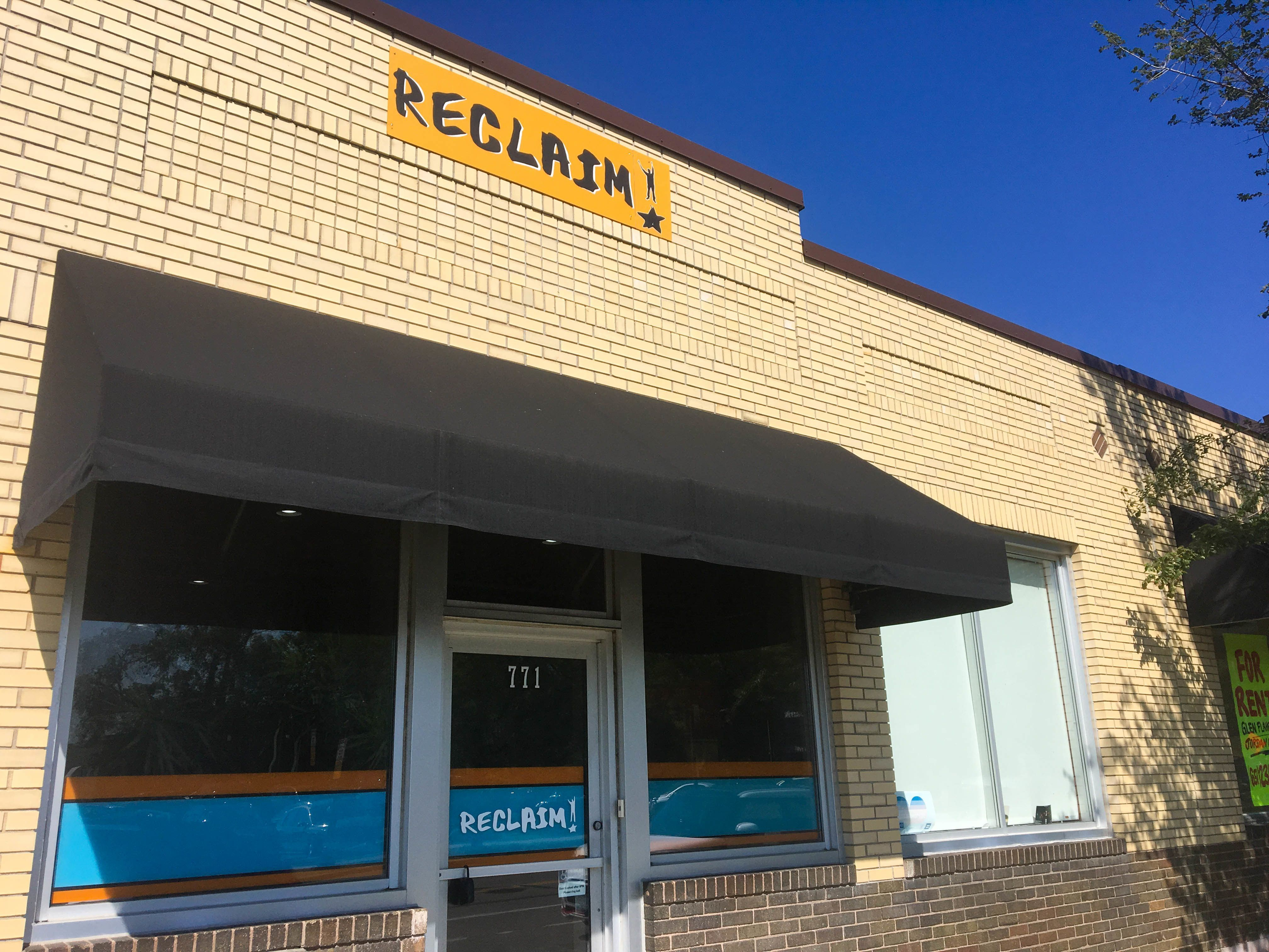 A picture of RECLAIM's office building from the front sidewalk.