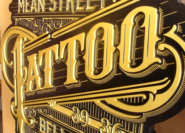 S28078A - Close-up of  Side View of  a Sign for Tattoo Parlor