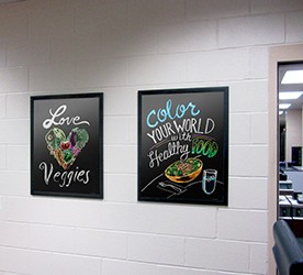 Chalk art food images on a school wall in a flip open frame, food posters, nutrition education