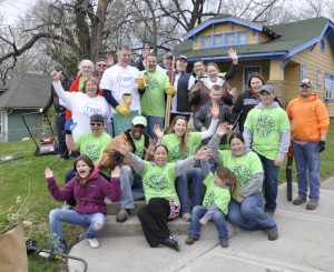 Volunteer group for Planting Independence holding up hands