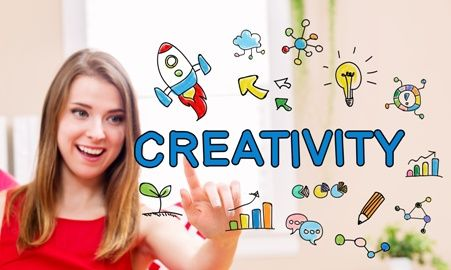"young woman pointing toward graphic reading ""creativity"" and surrounded by drawn graphics"