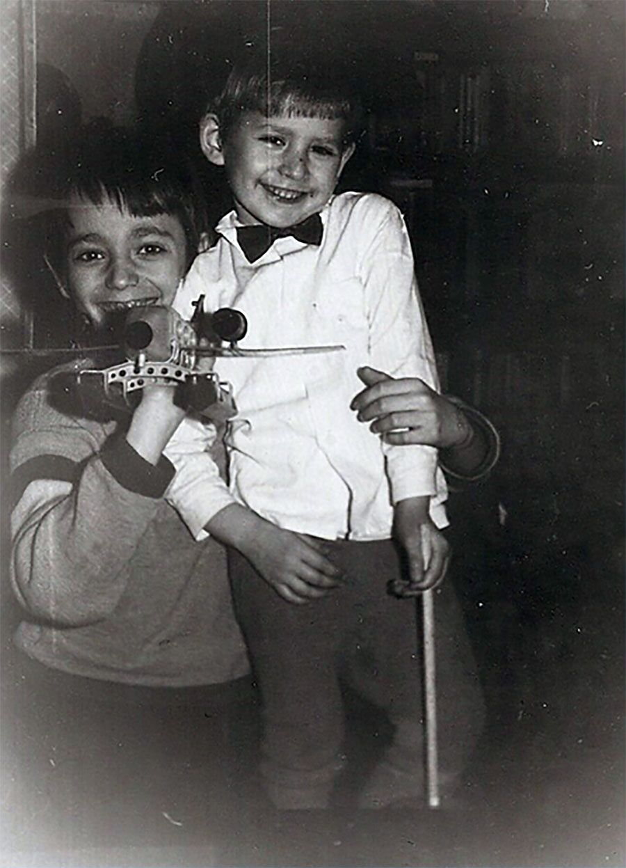 Gregory and Bella's children playing in Kazan (L) and building their first Sukkah (R)