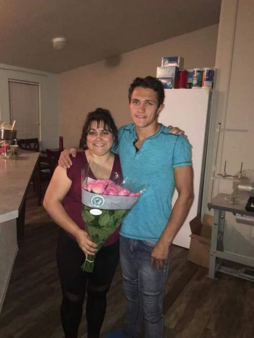 Merlin Dutson with his mother who is holding pink roses