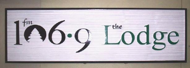 "SA28596 - Wood-Grain High Density Urethane Sign for Radio Station ""106.9 Lodge"""