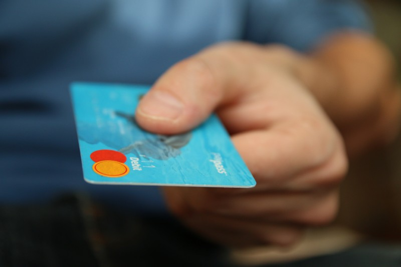Loyal customer buying from business with debit card