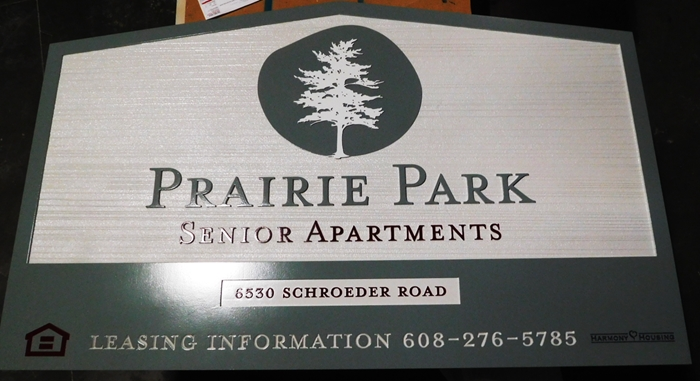 "K20339 - Carved HDU Entrance Sign,  for the ""Prairie Park"" Apartment with Wood Grain Sandblasted Background"
