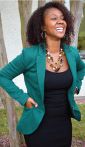 Female college student wearing a teal blazer.