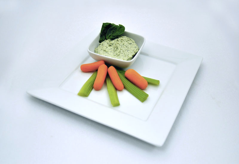 Baby carrots and celery with spinach dip
