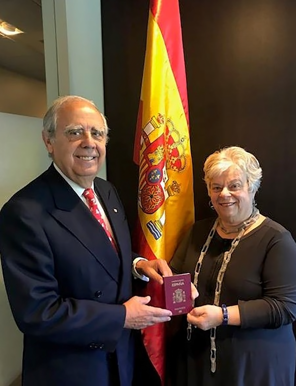 Doreen being presented her new Spanish passport by the Honorary Consul of Spain, Luis Fernando Esteban.