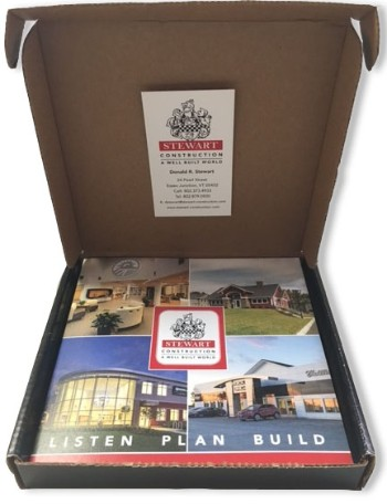 Open box with stewart construction brochure inside