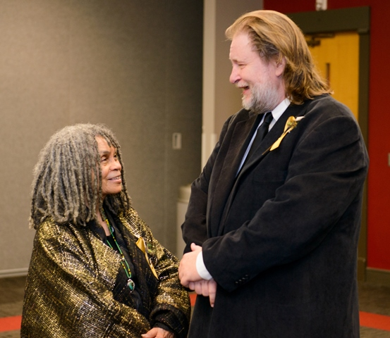 Inductees Sonia Sanchez and Rick Bragg chat in the media green room.