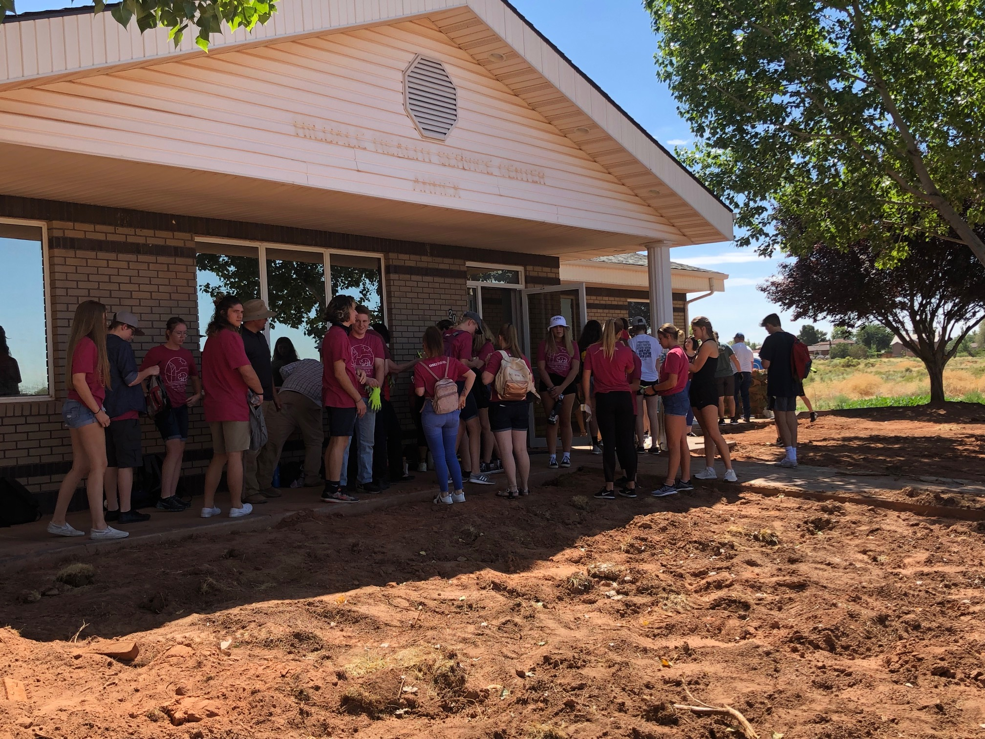DSU students prepare to lay sod at the Creek Valley Health Center in polygamist community of Colorado City