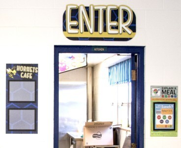 School signs in cafeteria, custom menu board with school mascot, enter sign, explain a meal