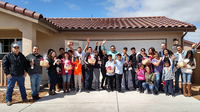 Eight families in San Miguel celebrate becoming first-time homeowners