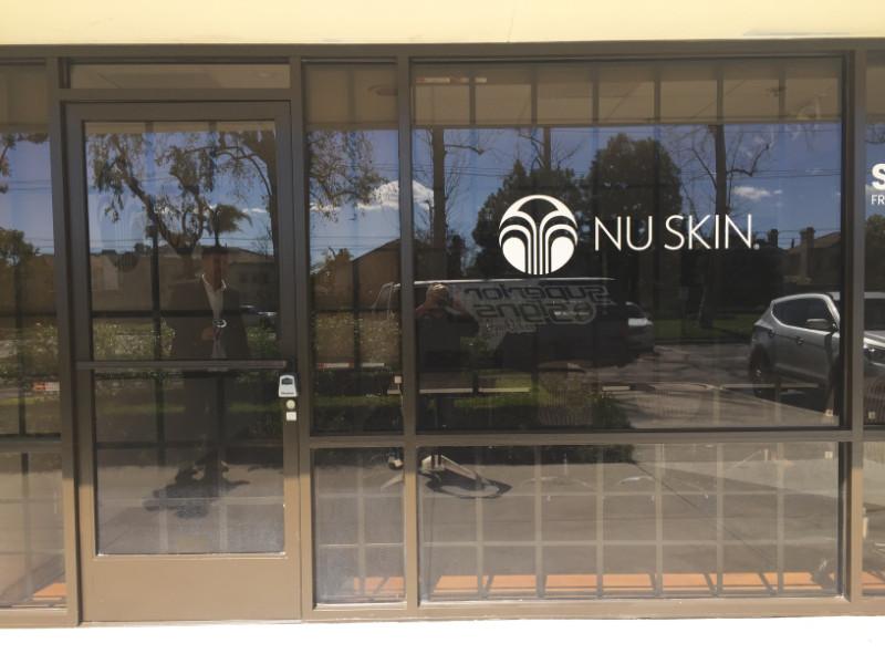 Brand-building vinyl window lettering Cypress CA