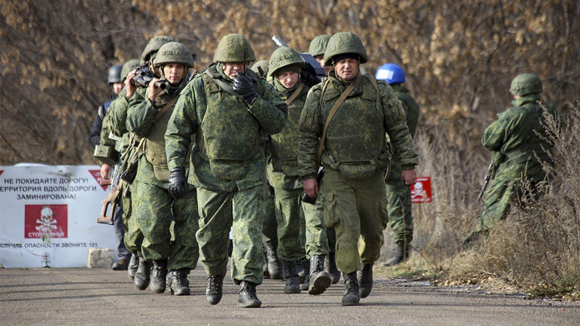 Ukrainian forces, Russian-backed separatists begin pullback in war-torn Donbass