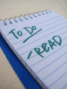 "Spiral notepad saying ""to do: read"""