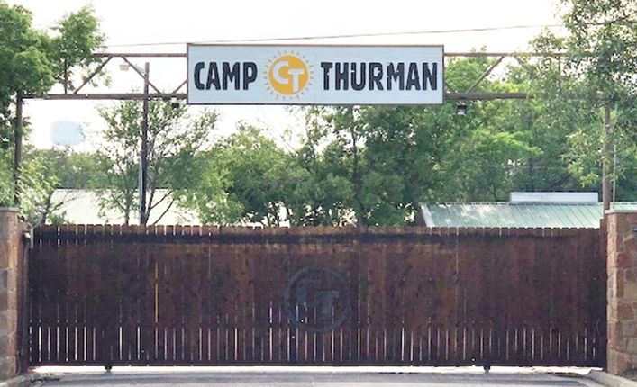 G16322 - Large Carved and Sandblasted HDU Entrance Sign for Camp Thurman, Mounted on Overhead Steel Truss