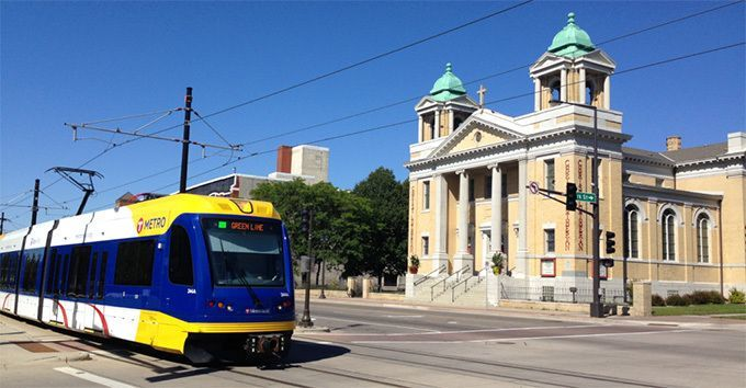 Light rail train passing Christ on Capitol Hill Church where Daily Work is located