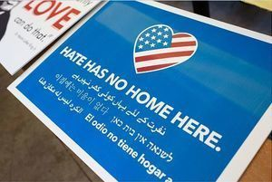 Lawn sign reads Hate Has No Home Here