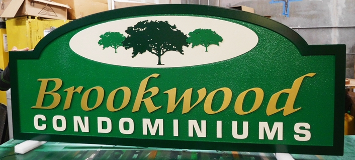 "K20331 - Carved HDU Entrance Sign  for the ""Brookwood "" Condominiums, with  Sandblasted Sandstone Texture Background"