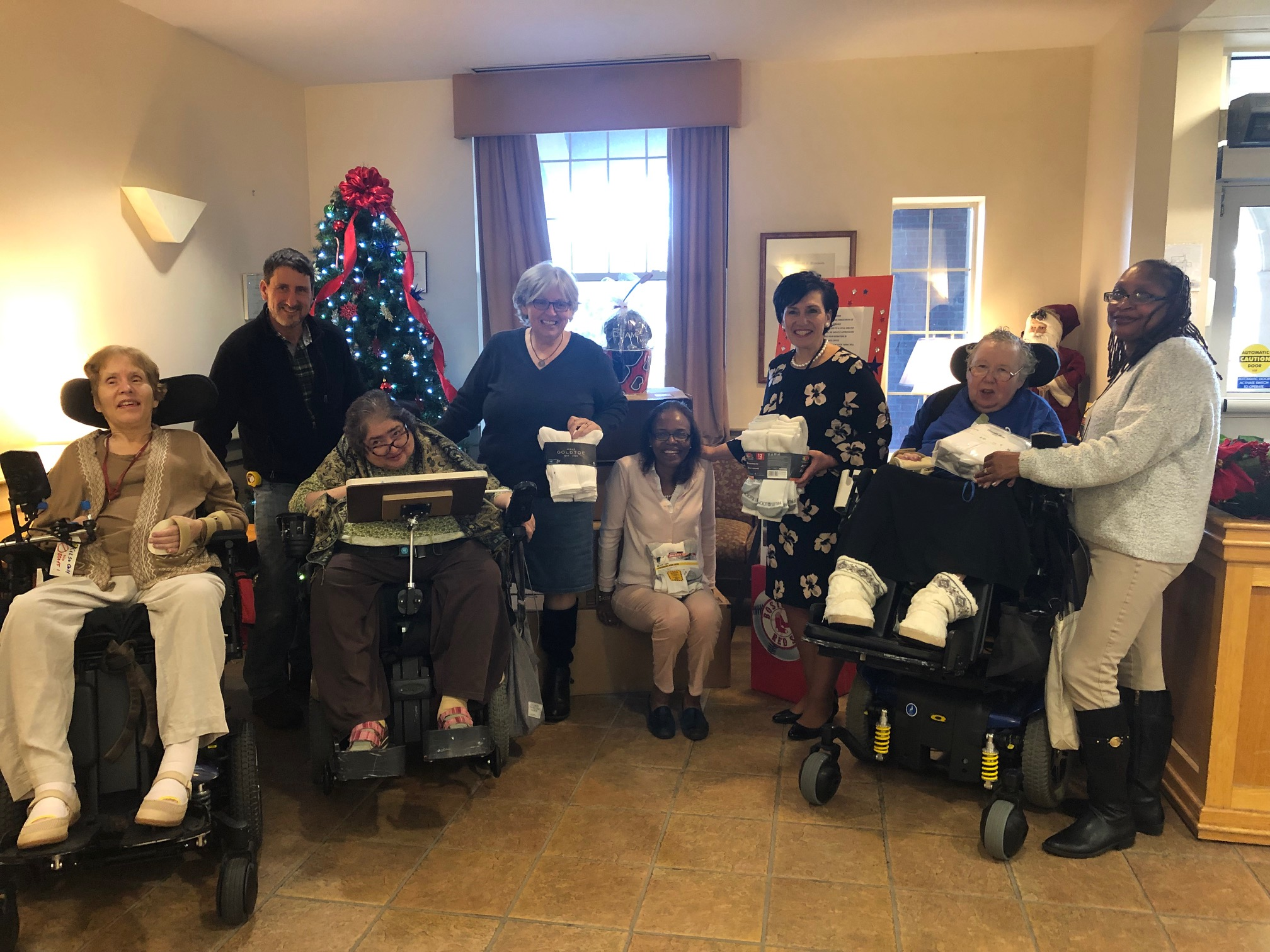 The Boston Home residents, staff and families donated over 600 pairs of white new socks to the Bay Cove Homeless Shelter