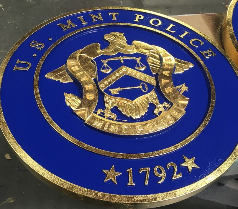 M7328  - Gold-Leaf Gilded  Plaque of the Seal of the US Mint Police,  with Blue Painted Background