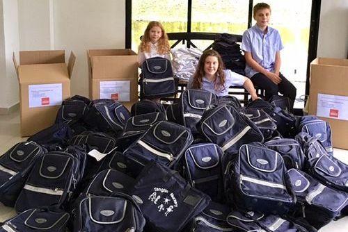 100 Backpacks