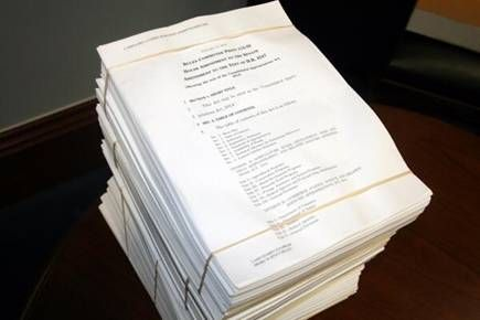 An image of the stack of papers for the increased funding request.