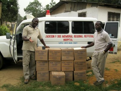 Rev. Amos Bolay Delivering Food to Churches