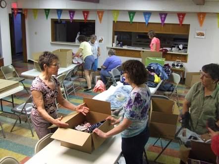 Volunteers sorting and packing donations
