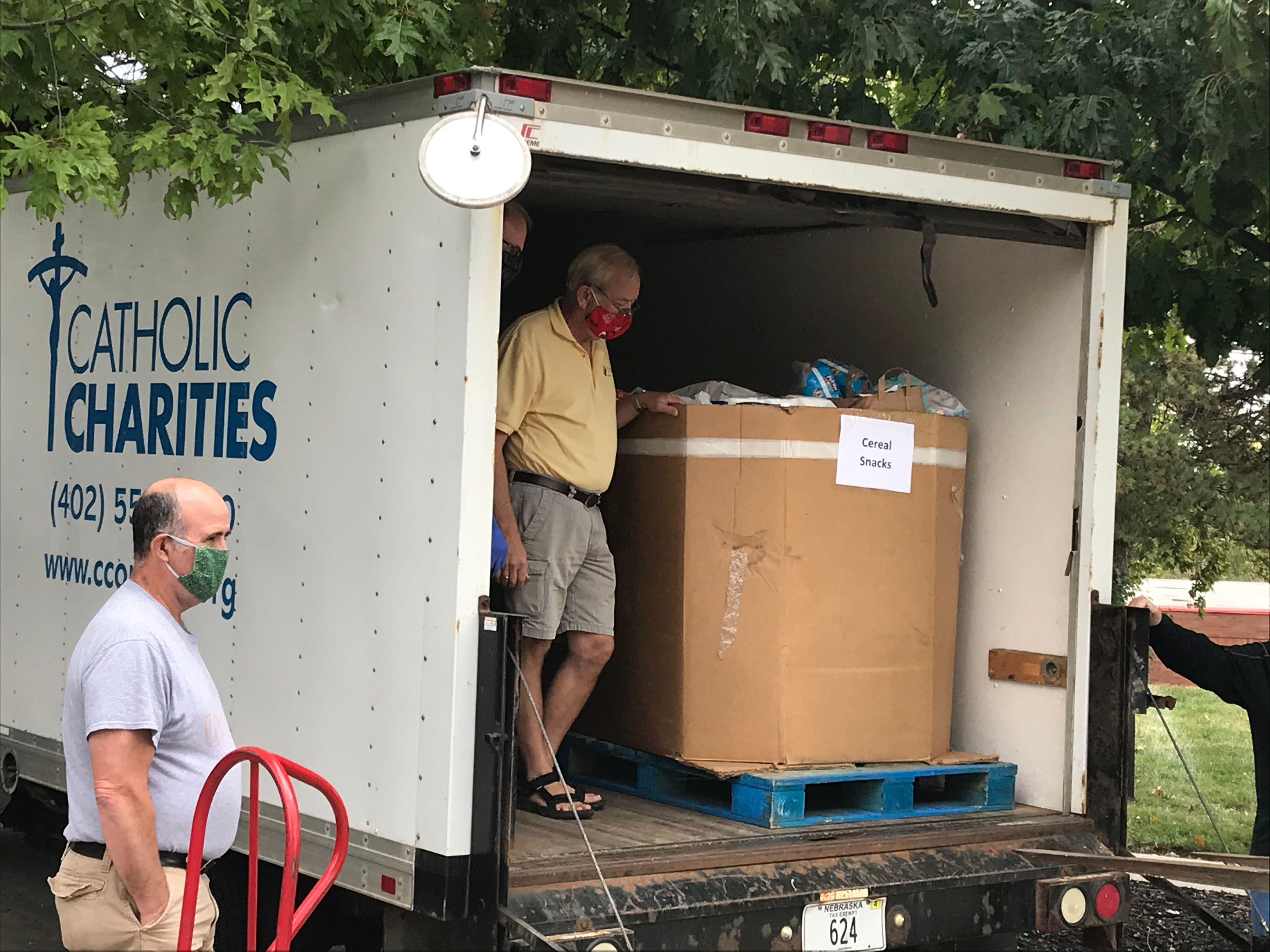 Ixim Helps Catholic Charities Community Food Drive