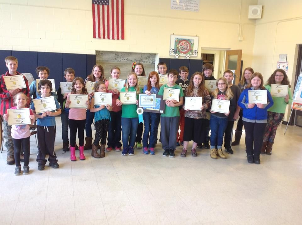 Three Lakes Academy students show off their certificates for the Student Art Show 2017