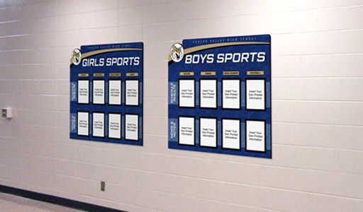 School hallway showing high school sports standing display, custom signs
