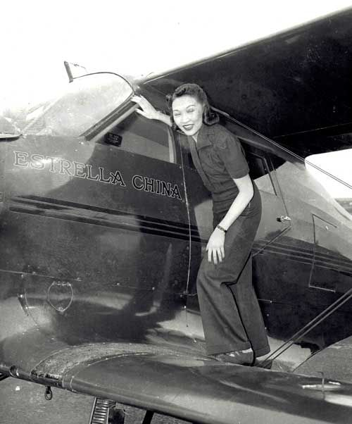 Lee Ya-Ching stands on the lower wing of a Beechcraft 'Estrella China', Roosevelt Field, L.I. 1940