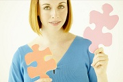 Blond Woman Holding 2 Puzzle Pieces