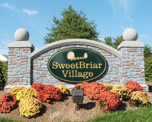 F15006 - Village Welcome Monument Sign, Stone Facade