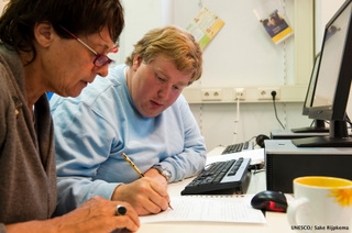 Tutor and adult student practicing workplace skills