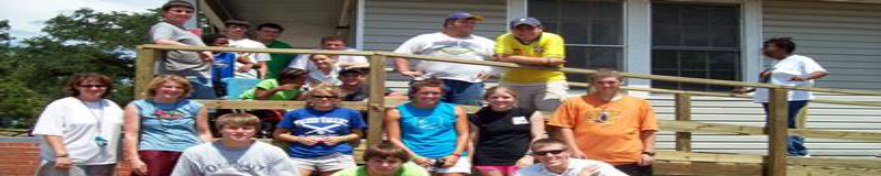Volunteers build a wheelchair ramp