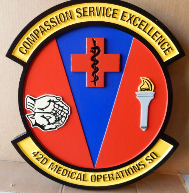 V31605 - Carved Wall Plaque of the Crest for the 42nd Medical Operations Squadron, US Air Force