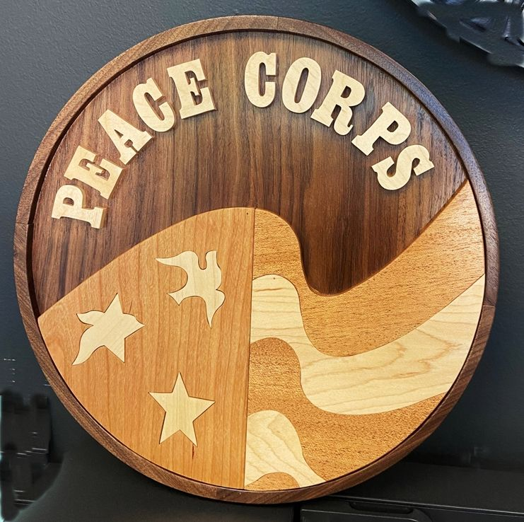 AP-3850 - Carved Wood Wall Plaque of the Seal of the Peace Corps, with Several Wood Sprcies